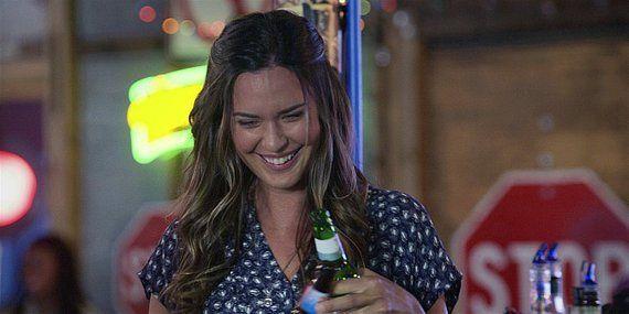 Walker Geri smiling at Cordell at Side Step bar.