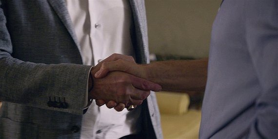 Walker close up on Stan shaking hands with LIam about campaign.