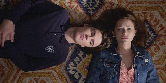 Walker Augie and STella laying on floor talking end of school year.