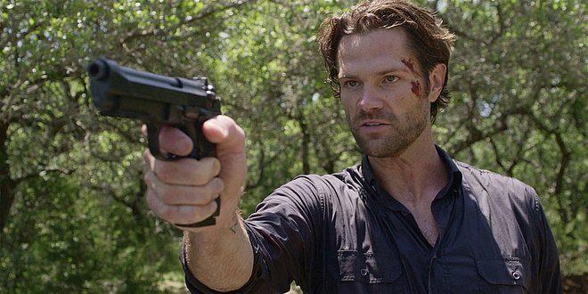 Walker Jared Padalecki looking fierce as he points gun at Stan.