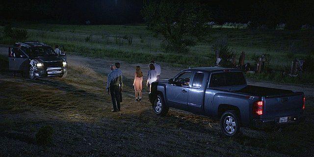 Walker family outside in trucks confronting Stan.
