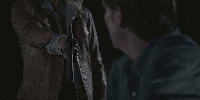 Walker Stan holding gun to shoot Emily dead Finale Season 1.