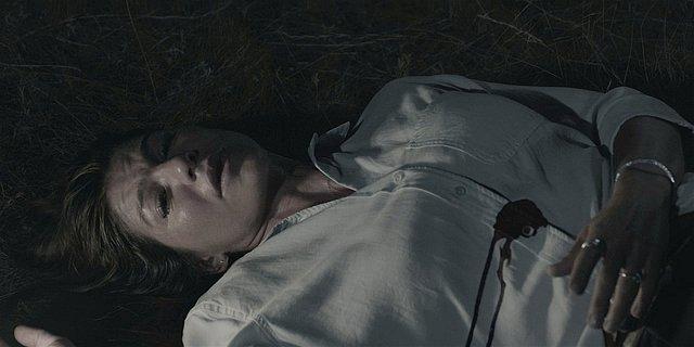 Walker Emily dead wife body shot in grass.