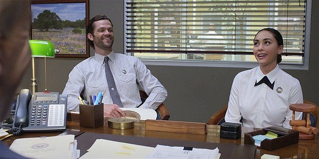 Walker Cordell and Micki laughing in sergeants office.
