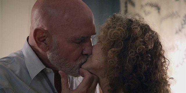 Walker Bonham kissing Molly Hagan hard for drive.